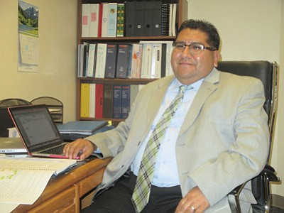 Director of federal programs for Hopi Jr./Sr. High School Alban Naha sits in his office. Photos/Stan Bindell