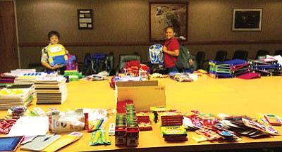 Debi Marquis (left) and Angie Gamble (right) prepare to pack more backpacks for Page students who may not be able to afford their school supplies. They deliver the backpacks to the schools, which then distribute them to students. Photo/Angie Gamble