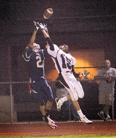 Hollins breaks up a Coronado Dons pass. Photo/Todd Roth