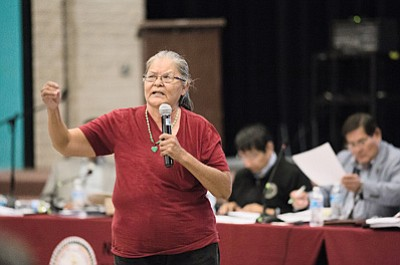 Rene Ellis speaks to Navajo Nation Vice President Jonathan Nez, Navajo Nation Council members, members of the Naabik'iyátí'Committee and more than 300 former Bennett Freeze area residents about the importance for basic needs like electricity and water during a Sept. 24 meeting in Tuba City. Ryan Williams/NHO