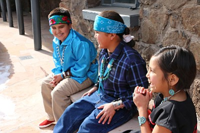 Kids at a Native Americans for Community Action (NACA) event laugh and enjoy traditional activities. Photo/NACA