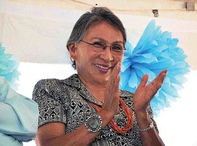 Winslow Indian Health Care Center CEO Sally Pete claps from the stage Aug. 28 during the grand opening ceremony of the Hozhoogo lina Wellness Center on the WIHCC campus.  Betsey Bruner/Courtesy WIHCC