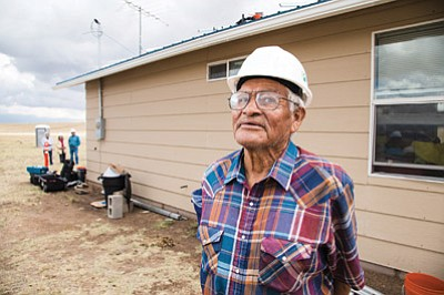 Henry Yazzie stands in front of his home about 10 miles outside of Leupp, Arizona and located in the former Bennett Freeze area. GRID Alternatives, a nonprofit organization, installed an off-grid solar system on Yazzie's roof. Ryan Williams/NHO