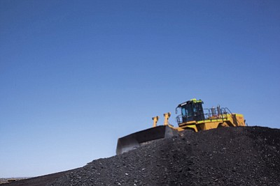 A bulldozer crawls over a pile of coal at Peabody's Kayenta mine on the Navajo Nation in this 2012 photo. Photo/Peabody Energy