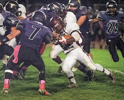 Winslow Bulldogs Darrien Brown fights his way through a tough Payson defense. The Bulldogs defeated Payson 27-16 Oct. 9 in Payson. Todd Roth/NHO