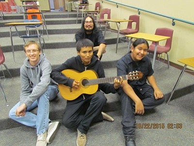 The 2015 Native American Composers Apprenticeship Program (NACAP) is in its 14th year at Tuba City High School. Michael Begay (back row) was this year's composer-mentor, a NACAP laureate from 2003 and member of the Navajo Nation. Front row from left:  Shane Moran, senior and third year NACAP student, Xavier Ben, freshman and first year NACAP student and Peyton Nez, sophomore and first year NACAP student. Rosanda Suetopka/NHO