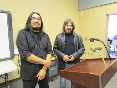 Michael Begay, NACAP laureate (left) and Lance Henson, renowned visiting poet scholar (right) work with Tuba City High School students in classical music instruction (Begay) and poetry and creative short stories (Henson). Photo/Rosanda Suetopka