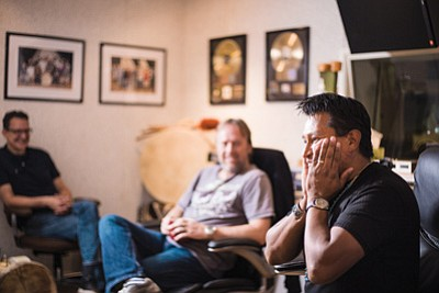 Jonah Littlesunday is overcome with emotion while talking about his journey to becoming a Canyon Records recording artist while Stephen Butler, Canyon Records director of production, and Russell Marsden, recording engineer, look on. Ryan Williams/NHO