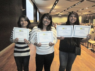 From left: Hopi High School radio students Kursheena Yazzie, Katrice Puhuhefvaya and Storm Tso display their Arizona Interscholastic Press Association state awards Oct. 27 at Arizona State University in Tempe. Photo/Stan Bindell