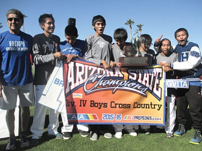 The 2015 Hopi High School state champion team celebrates after winning a 26th straight state title in Phoenix Nov. 7.  Photo/Stan Bindell