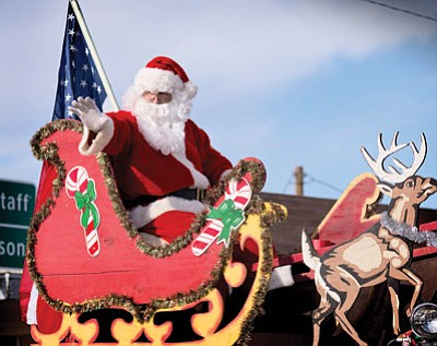 Santa Claus rides in last year's Winslow Christmas Parade. Claus will again participate in the parade, which takes place Saturday at 1 p.m. in Winslow. Todd Roth/NHO