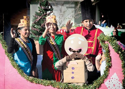 The Hopi Day School Princess and Brave wave to the crowd during the Winslow Christmas Parade Nov. 21. Todd Roth/NHO
