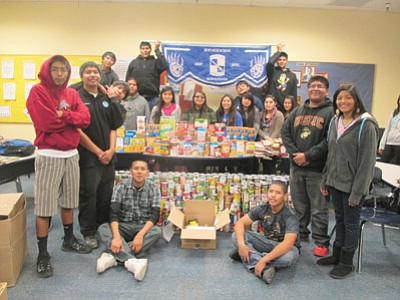 Hopi High Junior ROTC members display food they raised during a recent food drive. Stan Bindell/NHO
