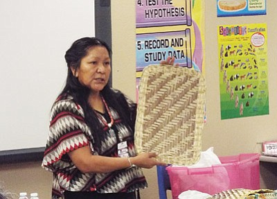 Dorleen Gashweseoma, an award winning master basket maker from Third Mesa, presents at this year's Tuba City School District cultural symposium that focused on Native American women's roles in contemporary Native life. Rosanda Suetopka/NHO
