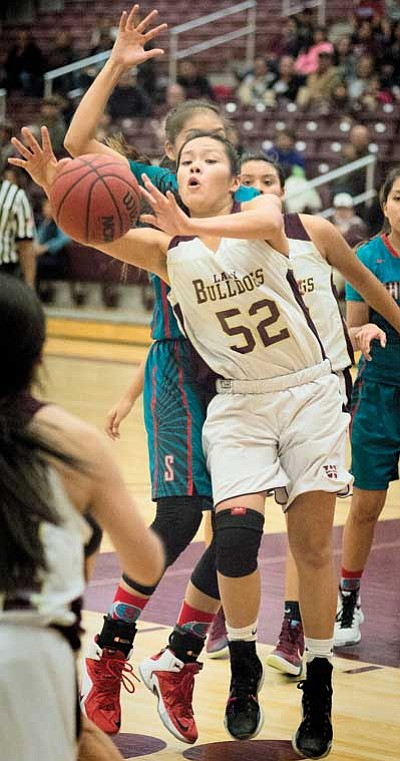 Winslow Lady Bulldogs' Jenna Yazzie, 52, gets off a pass. Todd Roth/NHO