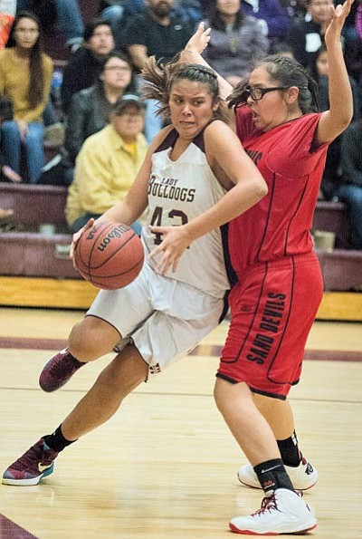 Lady Bulldogs' Justine Butterfield tries to get  past a Page defender. Photo/Todd Roth