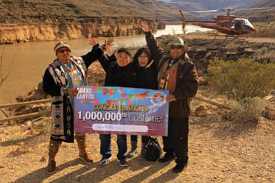 Grand Canyon West's one millionth visitors, Jenny and Mike Kim celebrate on the West Rim. Photo/Grand Canyon Resort Corporation