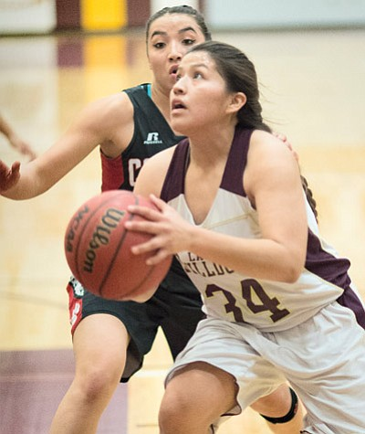 Winslow Lady Bulldog Adrianna Singer looks for two points during Winslow's 57-34 loss to Coconino Jan. 9. Todd Roth/NHO