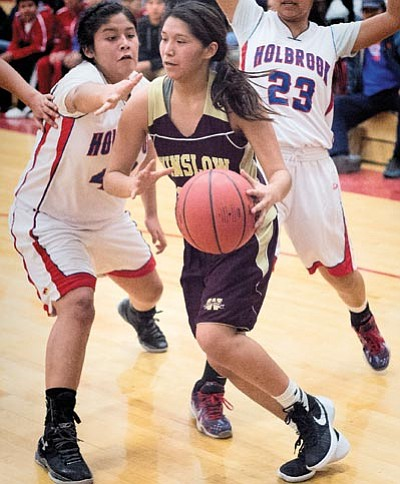 Danielle James moves through traffic Jan. 13 against Holbrook. Todd Roth/NHO