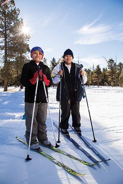Josiah Chavez (left) and Cedric Yazzie take a break from training at Flagstaff's Nordic Center for cross country Special Olympics skiing competition. Ryan Williams/NHO