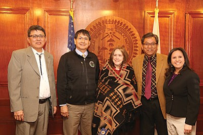 Navajo Nation Vice President Jonathan Nez (middle left) and President Russell Begaye (middle right) welcome Assistant Secretary of Army Corps of Engineers Jo Ellen Darcey with a traditional Navajo blanket. Darcy visited the Navajo Nation Jan. 27 to discuss Bennett Freeze development. Photo/Mihio Manus