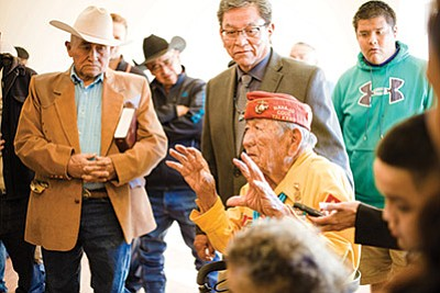 Navajo Code Talker Dan Akee recounts his time serving during World War II as his son Danny Akee (left) and Navajo Nation President Russell Begaye listen Feb. 6. Akee moved back into his family home after extensive renovations.