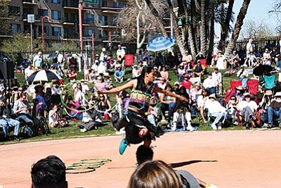 Nakotah LaRance performs during the 26th annual World Championship Hoop Dance competition Feb. 14. LaRance won the top prize for the second straight year. Katherine Locke/NHO