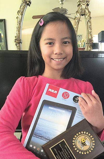 "Maria Macaraig, age 9, is the Western Navajo Agency 2016 Spelling Champion from Tuba City Primary School.  Macaraig took the top spot after spelling ""clandestine"" correctly.  She will now go onto to the larger Navajo Nation Spelling Bee in Crownpoint, New Mexico next month to compete. Photo/Rosanda Suetopka"