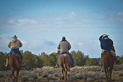 Riders in the New Lands, which is part of the Navajo Nation where Navajo families have been relocated. They were relocated after being moved off what became Hopi lands after a change in reservation boundaries. Photo/Bill Inman/Padres Mesa Ranch