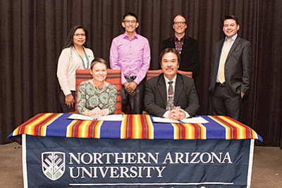Front row: NAU President Rita Cheng, Diné College President Martin Ahumada. Back row: Theresa Hatatulie, Diné Board of Regents, Aaron Lee, student representative, Diné Board of Regents, NAU's Chad Hamill and Greg Bigman, Diné College Board of Regents.  Photo/NAU News