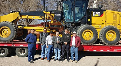 Navajo Nation Council Delegate Edmund Yazzie and Navajo Nation Vice President Jonathan Nez stand with Iyanbito Chapter officials and New Mexico legislators March 11 in front of a new road grader. Submitted photo