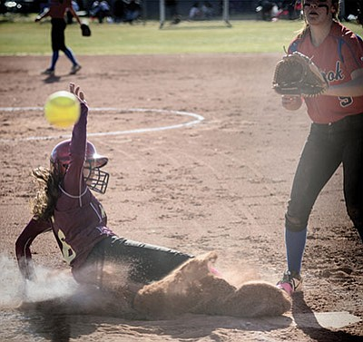 Sierra Wilcox slides into home before the ball arrives against Holbrook March 15. Photo/Todd Roth
