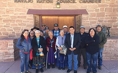 Tsidi To ii constituents gather with Council Delegate Otto Tso after the Navajo Nation Council's approval of funding for a power line extension in the community. Submitted photo