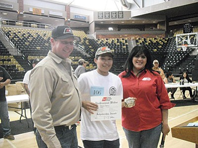 Steven Charley (center), a senior at Tuba City High in the Career Technical Education (CTE) welding program, took the $5,000 full scholarship to the Tulsa Welding School grand prize at the annual Native Skills competition that took place this year at Chinle High School. Charley stands with Jenny Pacheco (right, an administrator at the Tulsa Welding School along with another Tulsa Welding School staff member who were present to award the winning Tuba City High School senior. Rosanda Suetopka/NHO