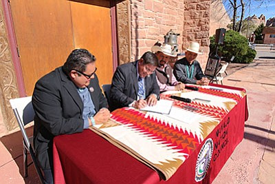 Navajo Nation Council Speaker signs legislation which aims to increase economic, community and agricultural development throughout the Navajo Nation — $30 million a year for the next five years. Submitted photo
