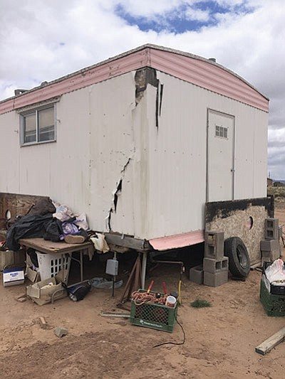Red Feather, a nonprofit group, is weatherizing a 7-foot rip in the siding of a trailer to reduce air leakage by more than 56 percent.  Submitted photo