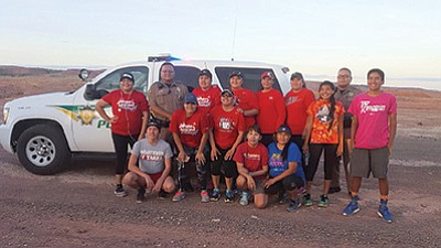 A group of Tuba City community members participated in a memorial run May 4 in Tuba City in remembrance of Ashlynn Mike who was abducted and killed in New Mexico. Backrow from left: Nakia Eryn, Officer Ernie Gishie, Sarah Thompson, Melissa Begody, Patrice Dele, Claudia Littleman, unknown, Officer Donald Seimy and Taylor Begody. Front row from left: Leon Manygoats, Kristy Nez, Crystal Begody, Unknown, Caroline Dann Betoney and Chemarin Tsinnie. Submitted photo