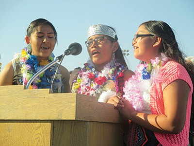 Yoiwmana Pooyouma, Brianna Miguel and Kaila Nez sing the national anthem at the Hopi Junior High promotion ceremony May 25. Stan Bindell/NHO