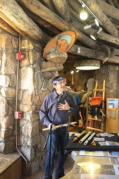 Ed Kabotie, grandson of Fred Kabotie, painter of many of the Watchtower's murals, speaks to visitors during a cultural demonstration at the Watchtower May 22. Loretta Yerian/WGCN