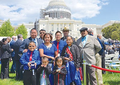 Officer Alex K. Yazzie's family stands in front of the White House. Yazzie was recognized during the annual National Peace Officers' Memorial Service in Washington D.C. May 22. Yazzie passed away a year ago. Submitted photo