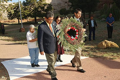 Navajo Nation President Russell Begaye, Vice President Jonathan Nez and Gold Star mother Isabelle Shondee laid a wreath on the Veterans Memorial Wall in Window Rock on Memorial Day in honor of all fallen veterans. Submitted photo