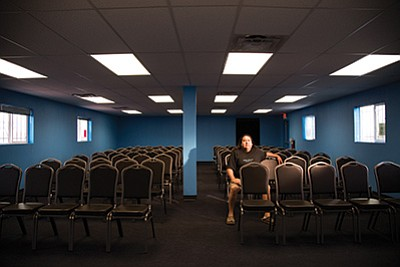 Cameron Chapter President Milton Tso sits in a new chapter house with comfortable chairs and air conditioning. Tso hopes community members will fill seats and get involved. Ryan Williams/NHO