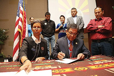 Arizona Department of Veterans Services Director Wanda Wright and Navajo Nation President Russell Begaye sign a Memorandum of Understanding that will make it easier for veterans to file claims for services on the Nation. Submitted photo