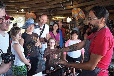 Artist Jonah Hill demonstrates his metalsmithing at Desert View Watchtower July 8.  Loretta Yerian/NHO and Jonah Hill