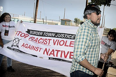 Border Town Justice Coalition July 29 marches in Winslow protesting Maricopa County's decision to clear Winslow Police officer Austin Shipley in the fatal shooting of Loreal Tsingine, a 27-year-old Navajo woman while attempting to arrest her. Todd Roth/NHO