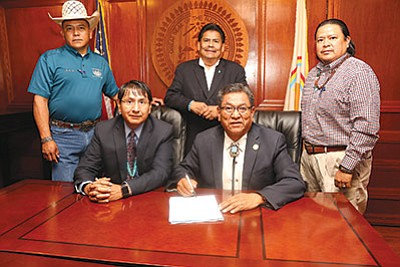 Navajo Nation President Russell Begaye and Vice President Jonathan Nez signed legislation enacting the Navajo Nation Land Acquistion Act Aug. 10. Submitted photo
