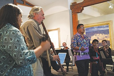 From left: Simana Tenakhongva, flautist Gary Stroutsos and Clark Tenakhongva perform a new genre of Hopi music called Puhutawi at the Museum of Northern Arizona Aug. 28.  Loretta Yerian/NHO