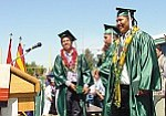 Photo by TC District Media Warrior seniors who led their class in formally turning their tassels, included Ray Tsinnie, left, Matthew Logg, Shonie Yazzie and Cheabon Dawavendewa.