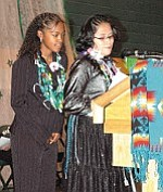 Photo by TC District Media Maria Byars, left, TC Junior High Student Council President, introduces Stephanie Fowler, one of 10 students speakers at the Braves graduation on May 24.