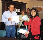 Photo by George Hardeen Navajo Nation First Lady Vikki Shirley presents a MADD membership certificate to Sgt. Raymond Joe of the Window Rock District. Loretta Redhouse of the Chinle District and Officer Ron Brown of Tuba City District are also members of the new Navajo Nation MADD DUI Task Force.